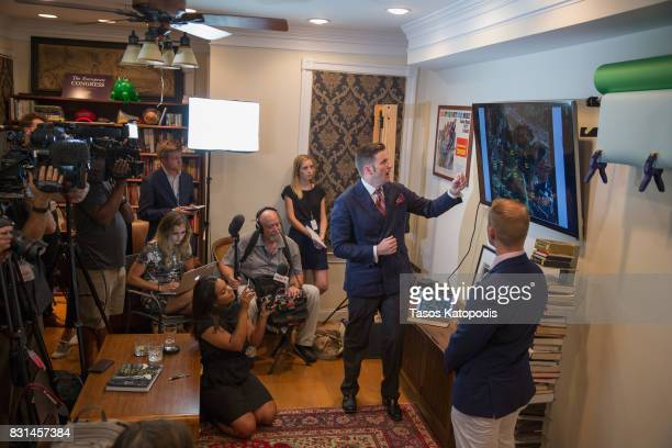 White nationalist Richard Spencer and Nathan Damigo of Identity Evropa speak to select media in a building serving as office space on August 14 2017...