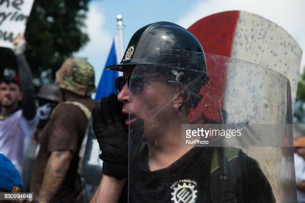 White nationalists neoNazis and members of the 'altright' are forced out of Lee Park after the 'Unite the Right' rally was declared an unlawful...