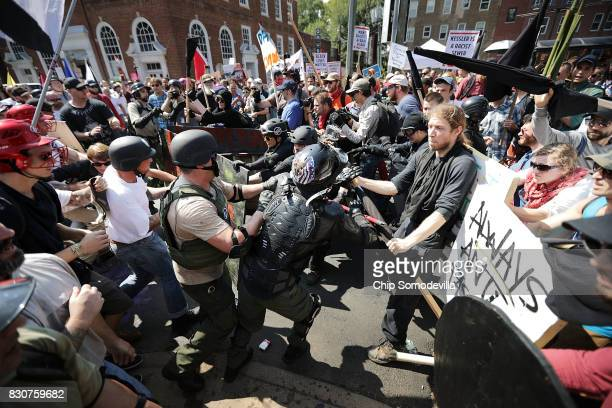 White nationalists neoNazis and members of the 'altright' clash with counterprotesters as they enter Emancipation Park during the 'Unite the Right'...