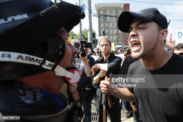White nationalists neoNazis and members of the 'altright' exchange insults with counterprotesters as they enter Emancipation Park during the 'Unite...
