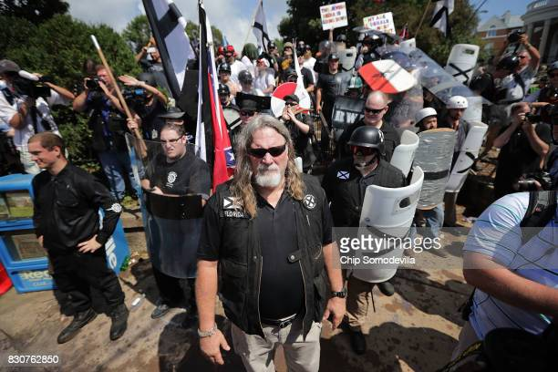 White nationalists neoNazis and members of the 'altright' exchange insluts with counterprotesters as they attempt to guard the entrance to...