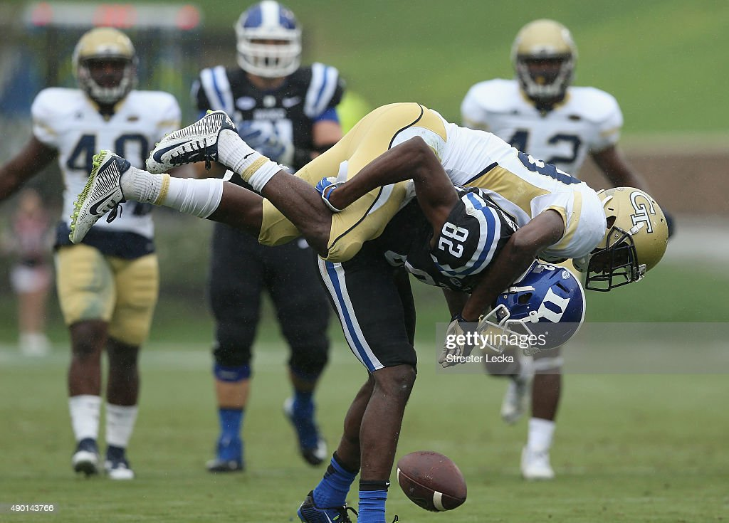 J White of the Georgia Tech Yellow Jackets tries to tackle Chris Taylor of the Duke Blue Devils during their game at Wallace Wade Stadium on...