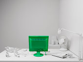 White Office with green computer