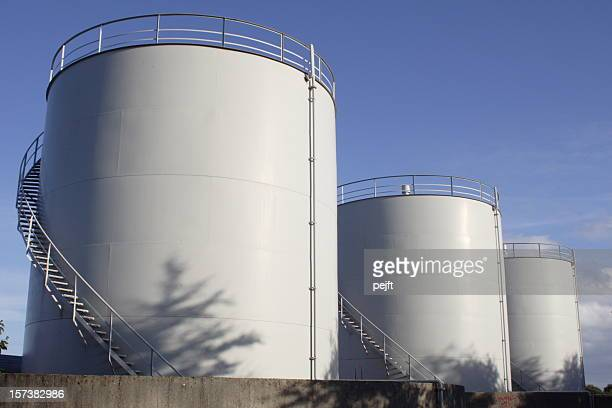 White oil tanks for storing fuel appear to be blank canvases