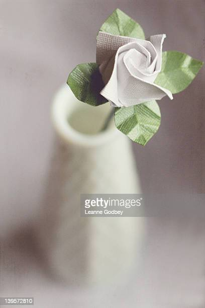 White origami flower in white vase