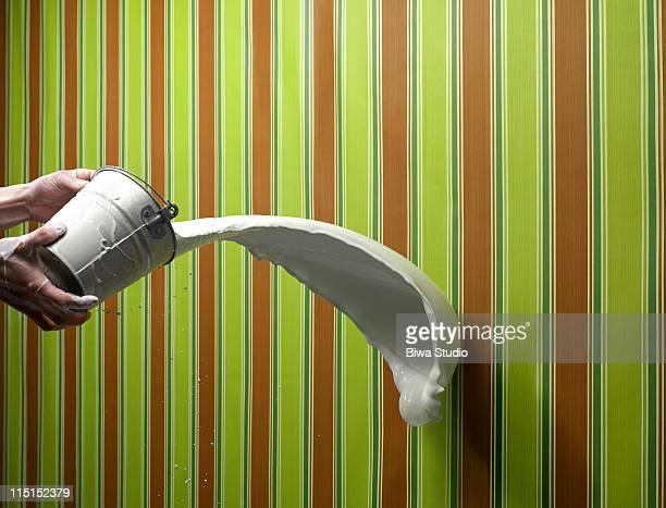 White paint splattering on stripe wallpaper