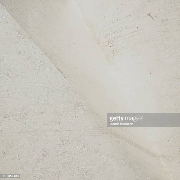 White painted plastered wall