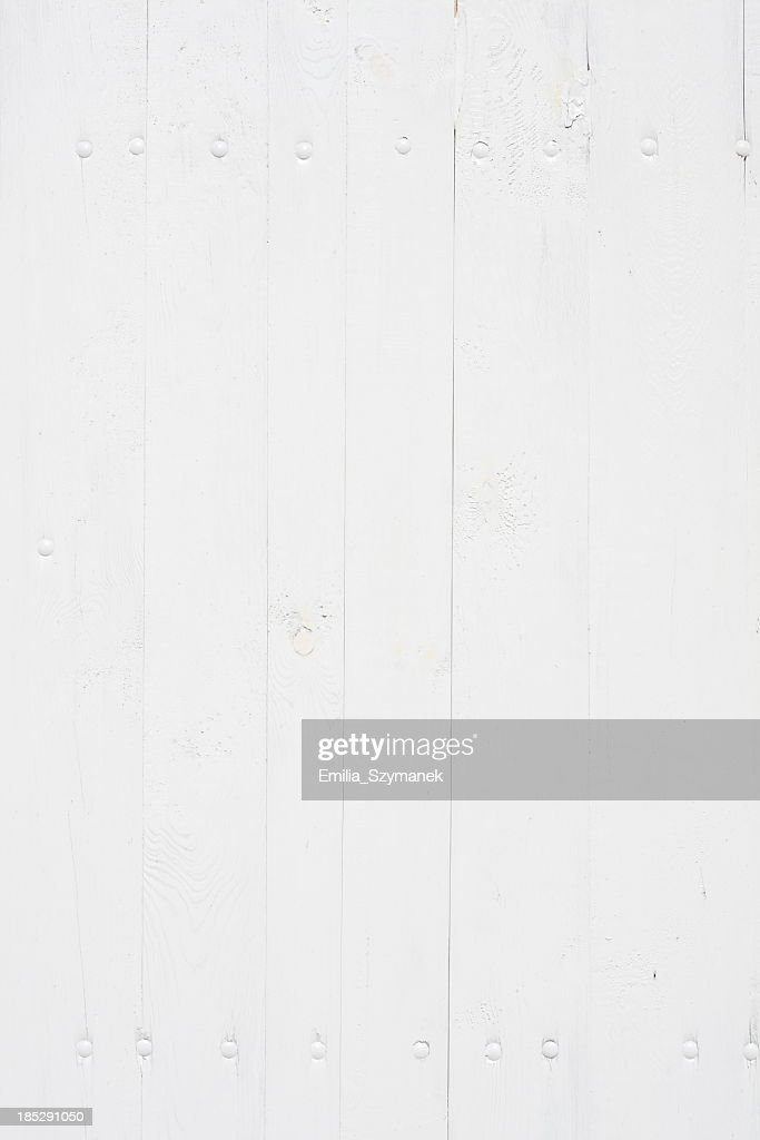 White painted wooden background.