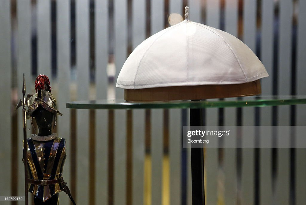 A white papal skull cap sits on display in the window of Gammarelli, an ecclesiastical tailors store in Rome, Italy, on Friday, Feb. 22, 2013. Gammarelli was founded in 1797 under Pope Pius VI as tailors to the clergy, and lists other papal customers as John Paul I, Paul VI, and John XXIII. Photographer: Alessia Pierdomenico/Bloomberg via Getty Images