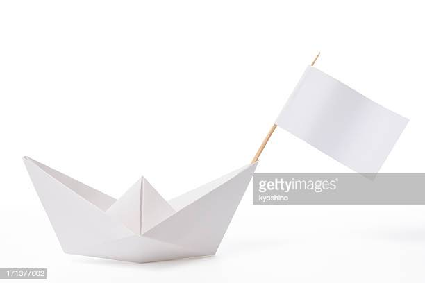 White paper boat with flag on white background