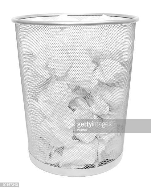 white paper in wire trash can - waste bin