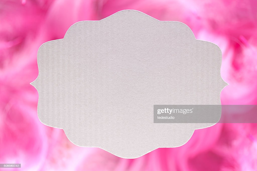 White paper label on pink background : Stock Photo