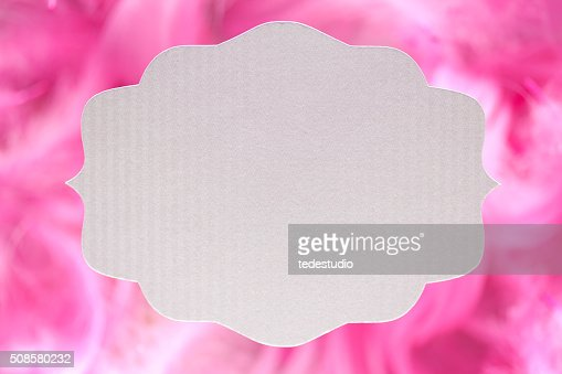White paper label on pink background : Stockfoto