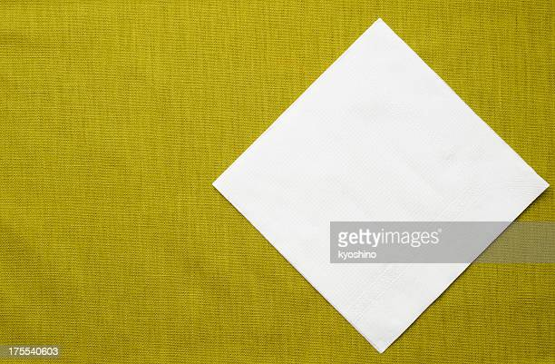 White paper napkin on green tablecloth with copy space
