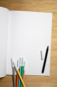 White paper notebook with color pens