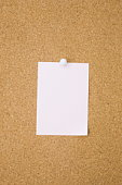 White paper tacked on cork board, copy space