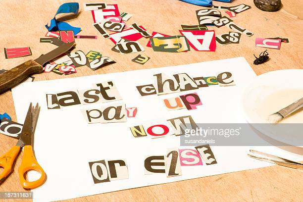 A white paper with magazine clips forming words