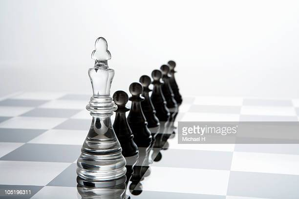 White pawns that queues up behind black king