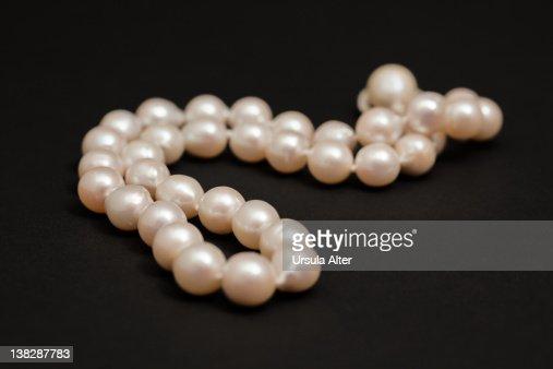 white pearls on black