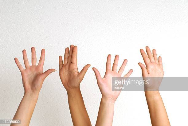 White people raising their hands