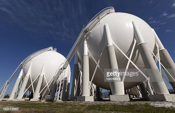 White petroleum storage tanks outside a petrochemical plant