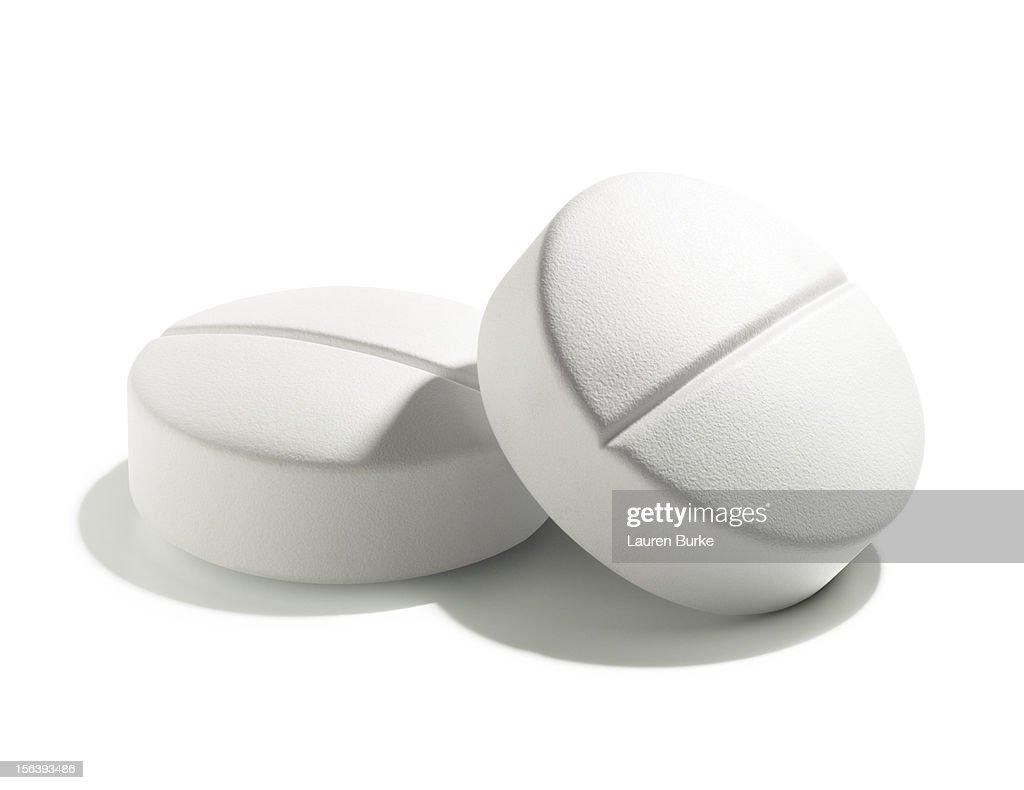 White pills on a white background : Stock Photo