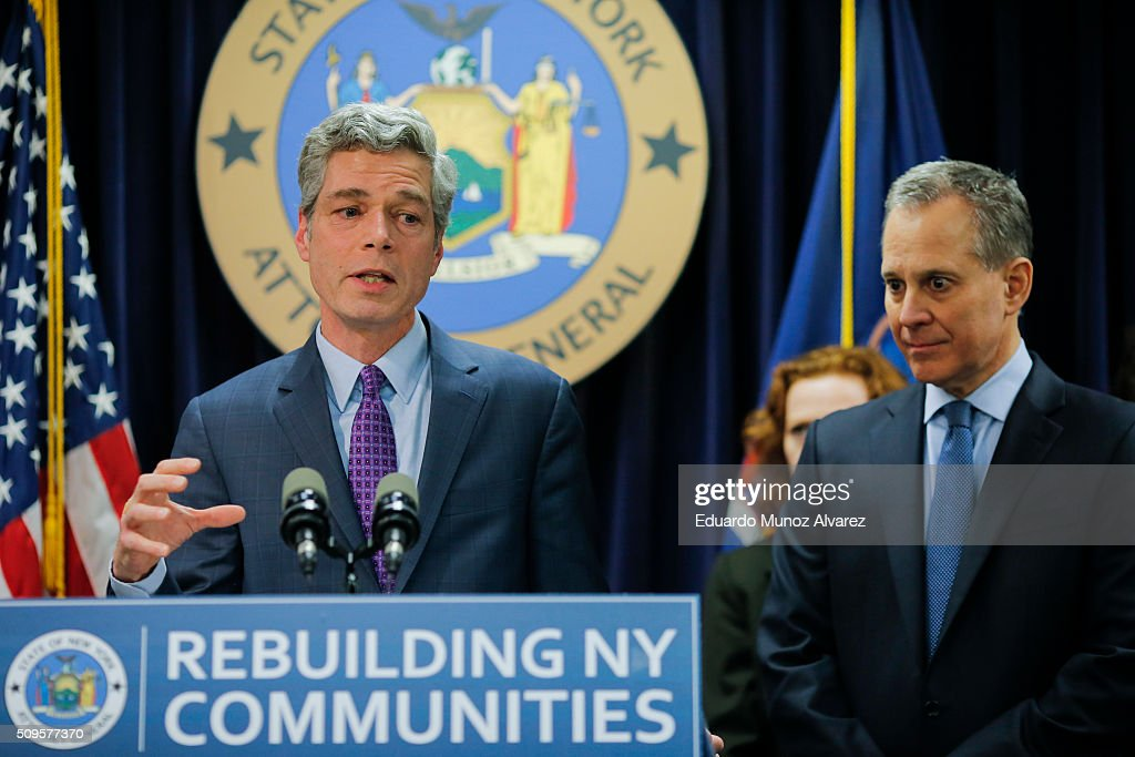 White Plains Mayor Tom Roach (L) speaks to the media next to New York Attorney General Eric Schneiderman at a news conference where attorney Schneiderman announced enforcement action against Morgan Stanley on February 11, 2016 in New York City. New York Attorney Schneiderman announced Morgan Stanley will pay a $3.2 billion settlement over the bank's practices leading up to the financial crisis.