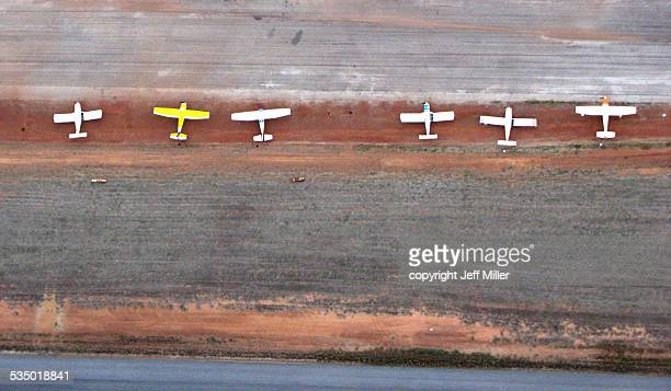 White Planes on Red Dirt Airstrip from Above