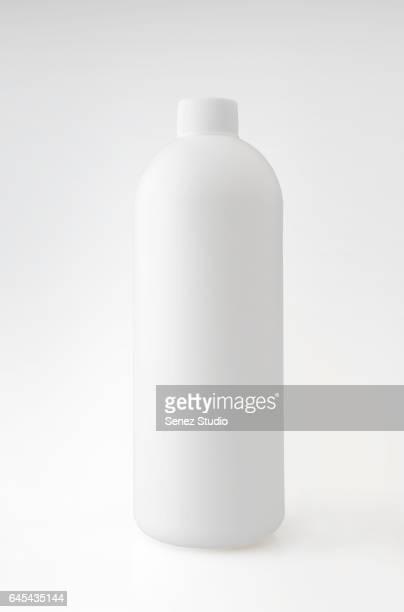 White Plastic Bottle Against White Background