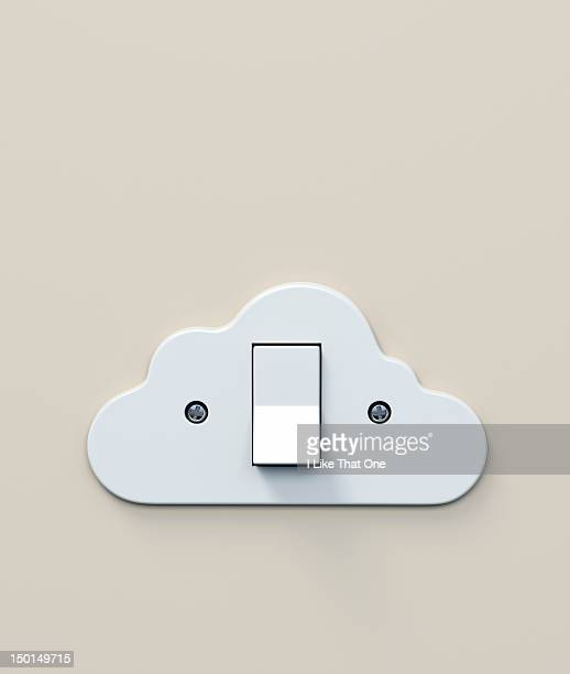 White plastic light switch in the shape of a cloud