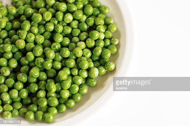 White plate full of peas