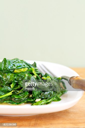 White Plate of Fresh Sauteed Spinach with Garlic