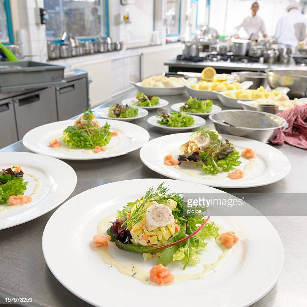 white plates with seafood salad ready to be served