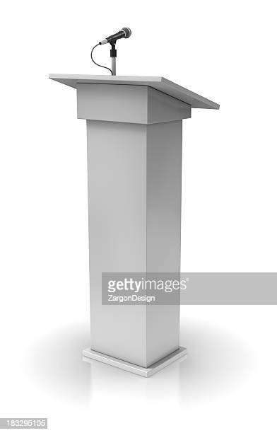 White podium with a single microphone