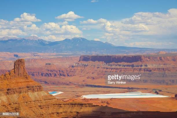 White ponds amid golden landscape at Dead Horse State Park, Utah