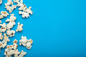 Popcorn with the copy space on the blue background.