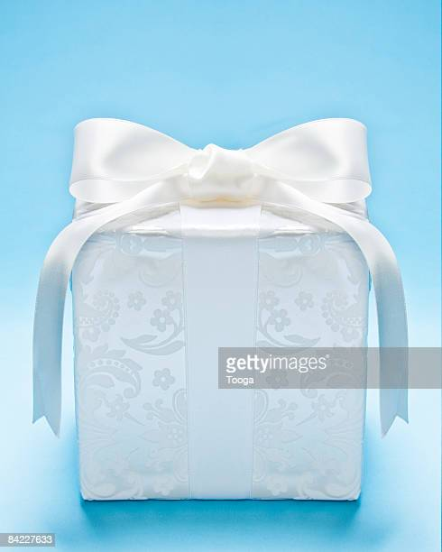 White present on blue background