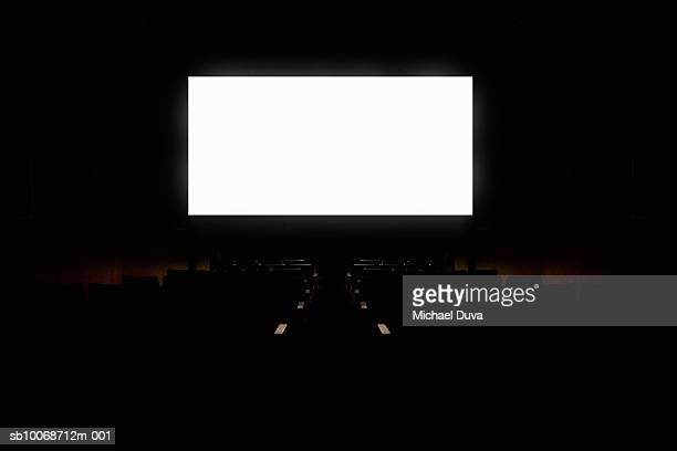 White projection screen in empty movie theatre (Digital Composite)