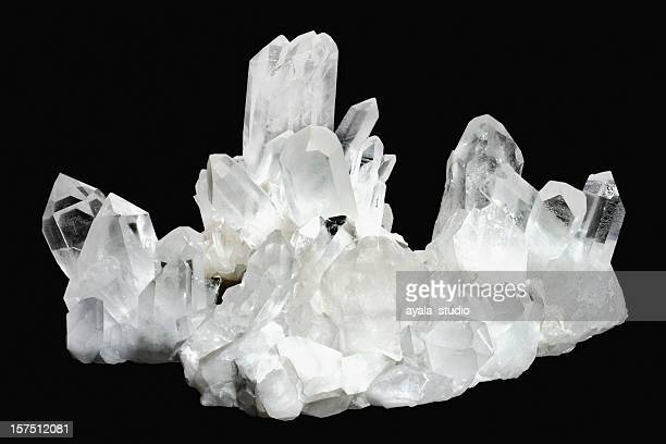 White quartz crystals on a black background