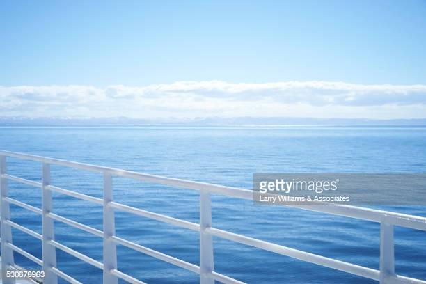 White railing overlooking seascape