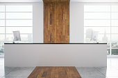 White reception desk in modern wooden interior with city view. 3D Rendering
