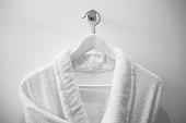 White robe on the hanger in the bathroom