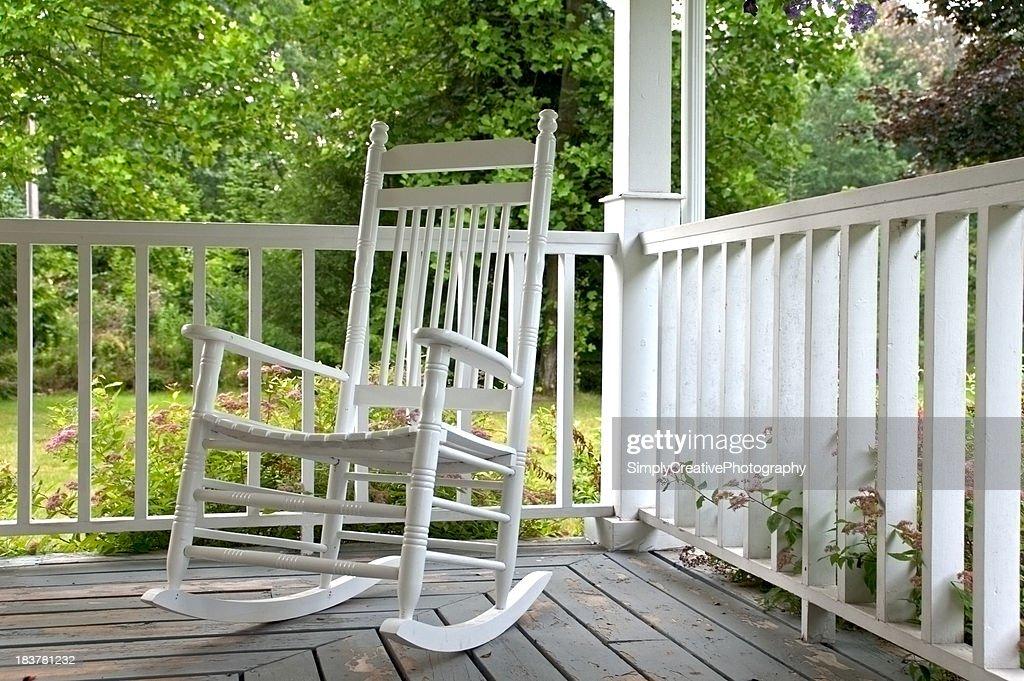 White Rocking Chair On Porch
