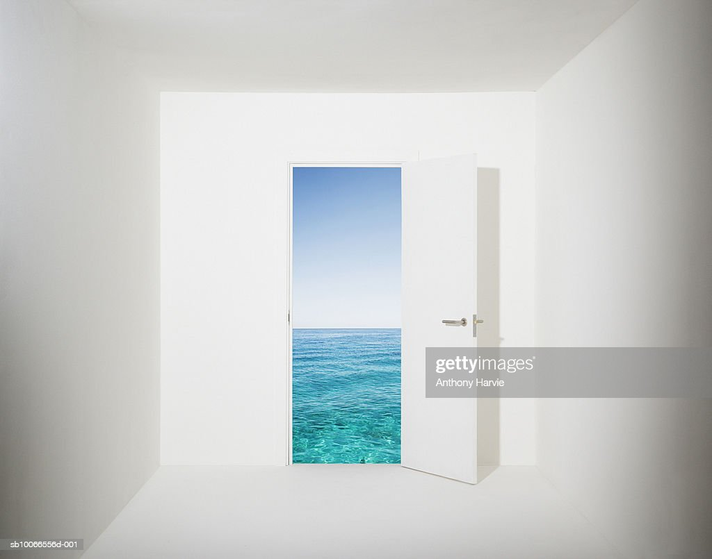 White room with aquamarine water and sky seen through open door (Digital Composite) : Stock Photo