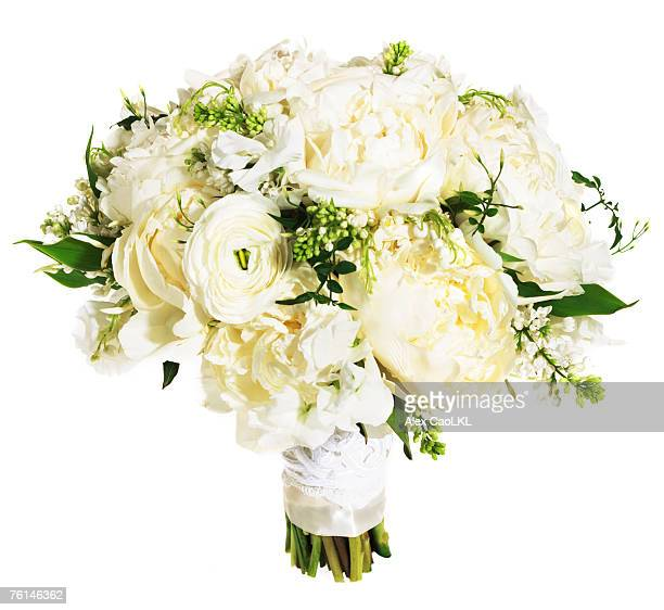 White rose floral bouquet bound with white ribbon
