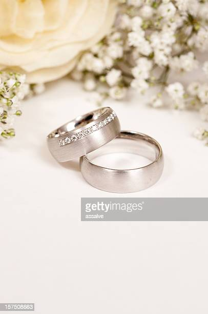 white rose with wedding ring and gypsohila