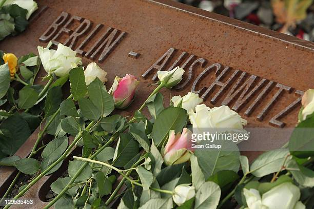 White roses left by mourners lie next to one of the many plaques detailing transports of Berlin Jews to concentration camps at the Gleis 17 memorial...