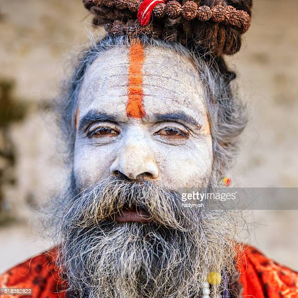 White Sadhu - indian holyman sitting in the temple