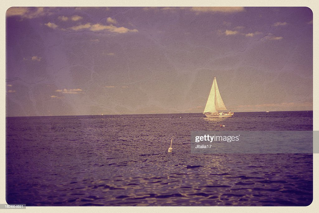 White Sailboat on Purple Ocean, Sky - Vintage Postcard : Stock Photo