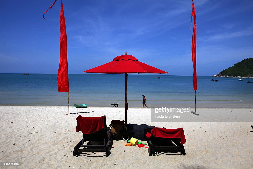 A white sand beach decorated by red umbrellas at the Anantara Rasananda resort June 18 2012 on the island of Koh Phangan off the coast of Koh Samui...